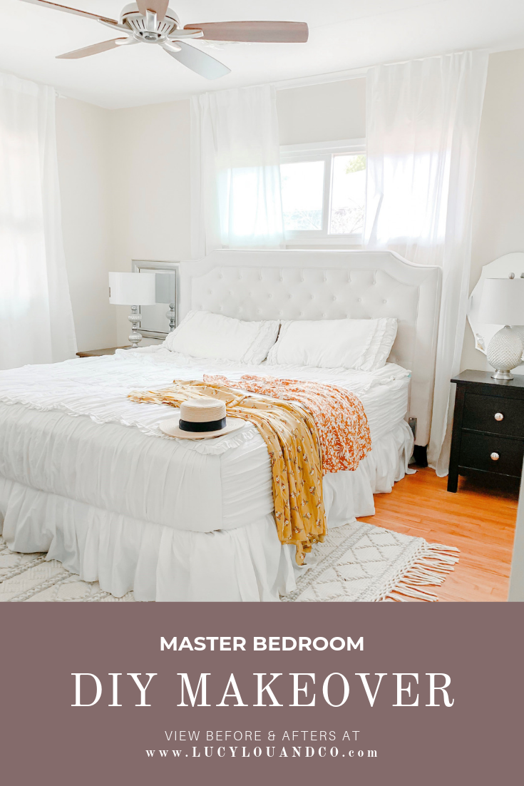 Master bedroom kind size bed with white bedding and tufted headboard