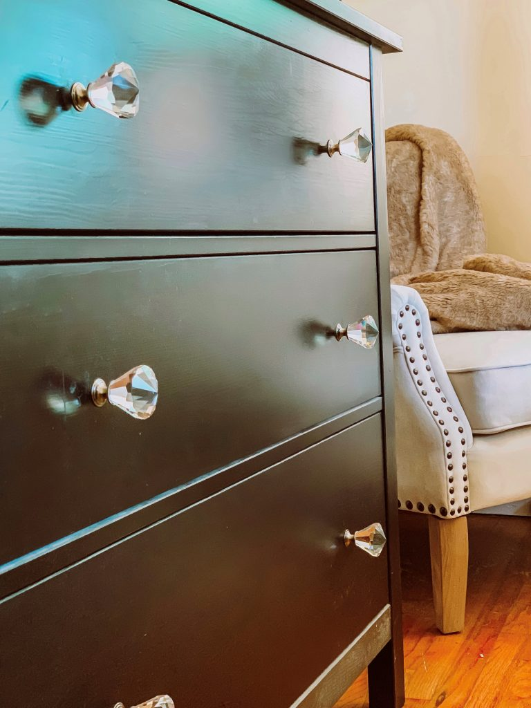brown dresser with crystal knobs